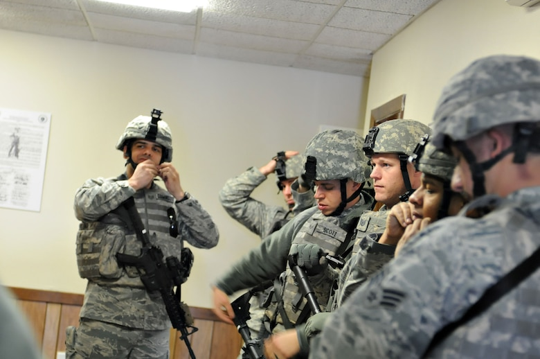 Members of the 102nd Security Forces Squadron perform a week of training which included weapons training, simulation training, using night vision equipment, and performed various physical fitness competitions throughout the week.(National Guard photo by Tech. Sgt. Kerri Cole/Released)