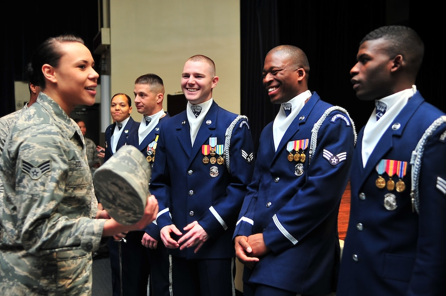 U.S. Air Force Senior Airman Amber Coley, 4th Medical Operations Squadron physical therapy technician, speaks to members of the U.S. Air Force Honor Guard Drill Team after a recruitment brief and demonstration on Seymour Johnson Air Force Base, N.C., Mar. 28, 2013. The drill team performs at public and military venues to recruit, retain and inspire Airmen. (U.S. Air Force photo by Airman 1st Class Aubrey White/Released)