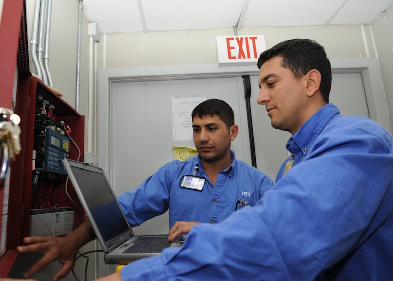 Mehmet Sami Sevinc and Ugur Uyar, both Vinnell-Brown and Root fire alarm technicians assigned to the 39th Civil Engineer Squadron, reset the fire suppression system in a dorm of Patriot Village, April 4, 2013, at Incirlik Air Base, Turkey.  The employees of VBR provide all maintenance and upkeep to facilities at Incirlik, including the lodging area for NATO service members temporarily stationed at Incirlik in support of the Patriot Mission to deter hostile actions near the Turkish-Syrian border. (U.S. Air Force photo by Staff Sgt. Marissa Tucker/Released)