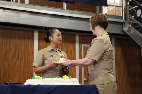 Master Chief Charlotte Osborn, command master chief, 1st Dental Battalion, 1st Marine Logistics Group, passes a piece of cake to Chief Petty Officer Sandra Go-Lubiano, a senior enlisted leader with 1st Dn. Bn., during the cake-cutting ceremony for the 120th anniversary of the chief petty officer rating, aboard Camp Pendleton, Calif., Monday, April 1, 2013. (U.S. Marine Corps photo by Cpl. Laura Gauna/Released)