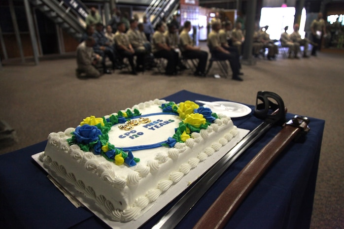 Sailors with 1st Dental Battalion, 1st Marine Logistics Group, prepare for the start of the 120th anniversary of the chief petty officer rating aboard Camp Pendleton, Calif., Monday, April 1, 2013. The cake-cutting ceremony is part of a tradition where the eldest chief petty officer passes a piece of cake to the youngest to symbolize the passing of wisdom and tradition. (U.S. Marine Corps photo by Cpl. Laura Gauna/Realeased)
