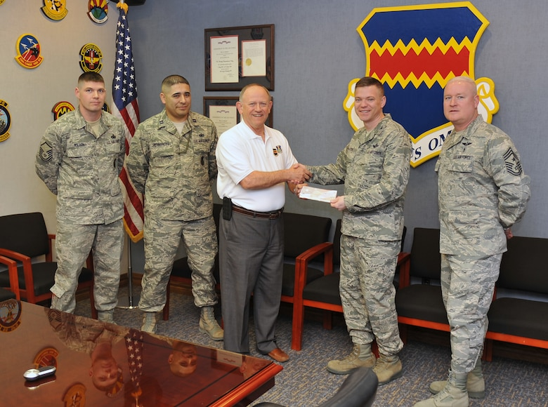 55th Wing Association makes dontion for annual birthday ball
