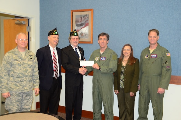 Steve Guyton (2nd from left), Boys State Program Director and Joe Kersh (3rd from left) Adjutant of The American Legion Mississippi Delta Post No. 1776, made a generous monetary donation while at the 172d AW Wednesday, April 4 2013.  Accepting the donation that will benefit the children of MSNG members was Brig Gen William J. Crisler (far left), MSANG Chief of Staff, Col Jonathan T. Wall (3rd from right), Commander of the 172d AW, Marianne Breland (2nd from right), 172d AW's Airman and Family Readiness Program Manager and Col James Hartline (far right),