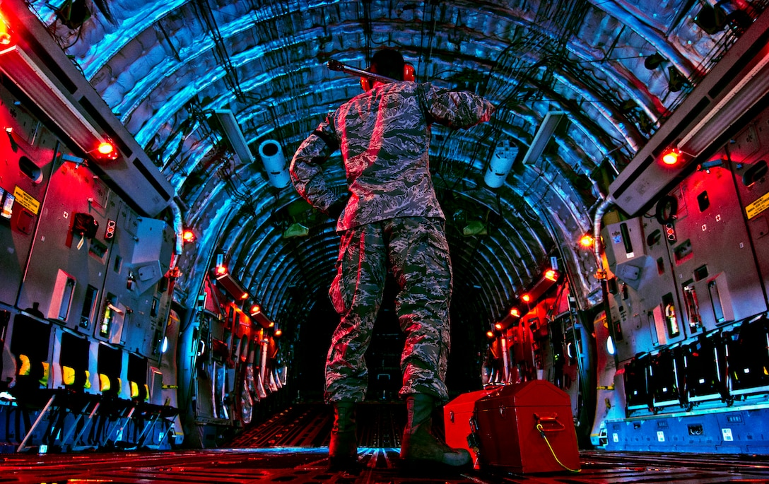 Senior Airman Joseph Farrell checks the inside of the C-17 Globemaster III before beginning a preflight inspection March 27, 2013, at Wright-Patterson Air Force Base, Ohio. Farrell is an electronic warfare systems journeyman assigned to the 445th Aircraft Maintenance Squadron. The C-17 can take off and land on runways as short as 3,500 feet and 90 feet wide. (U.S. Air Force/photo Staff Sgt. Mikhail Berlin)