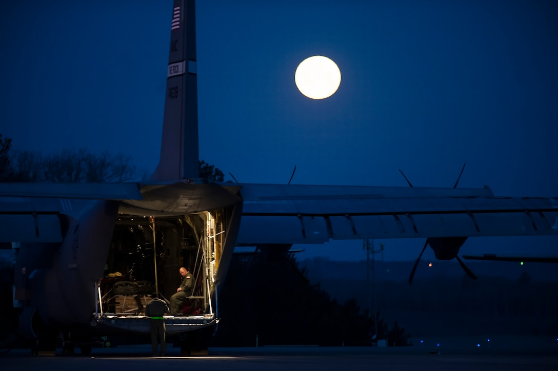 Beneath the light of a full moon, Airmen from the 19th Airlift Wing prepare a C-130J Hercules for a flight March 27, 2013, at Little Rock Air Force Base, Ark. The 19th Wing's responsibilities range from supplying humanitarian airlift relief to victims of disasters, to airdropping supplies and troops into the heart of contingency operations in hostile areas. (U.S. Air Force photo/Staff Sgt. Russ Scalf)