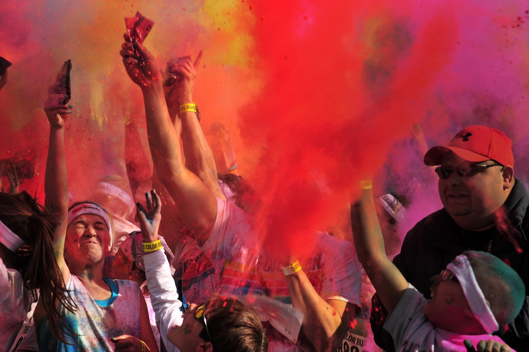 Colored powder is thrown into the air after participants complete The Color Run™ 5K March 23, 2013, in Lubbock, Texas. Airmen from Cannon Air Force Base, N.M, and members of the surrounding communities participated in the race. The Color Run™, also known as the Happiest 5k on the planet, is a unique paint race that celebrates healthiness, happiness, individuality and giving back to the community. (U.S. Air Force photo/2nd Lt. Angelica Powell)
