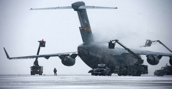 Airmen remove snow and ice from a C-17 Globemaster III March 25, 2013, at Joint Base Andrews, Md. Three to five inches of snow fell at Andrews, marking the first major snowstorm of the year in the area. The C-17 is assigned to assigned to Joint Base Charleston, S.C. (U.S. Air Force photo/Staff Sgt. Perry Aston)