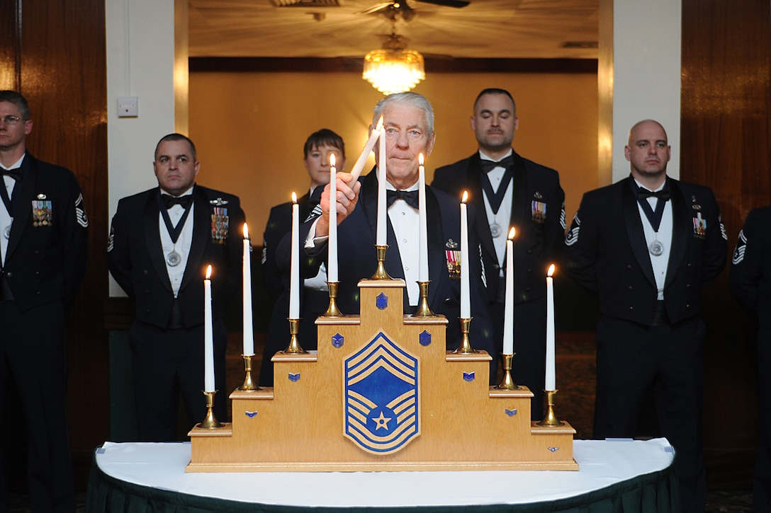 Retired Chief Master Sgt. of the Air Force Robert Gaylor lights the chief's candle during the Chief Master Sergeant Recognition Ceremony March 9, 2013, at Royal Air Force Lakenheath, England. The rank of chief master sergeant represents the top one percent of the enlisted force. (U.S. Air Force photo/Airman 1st Class Dana J. Butler)