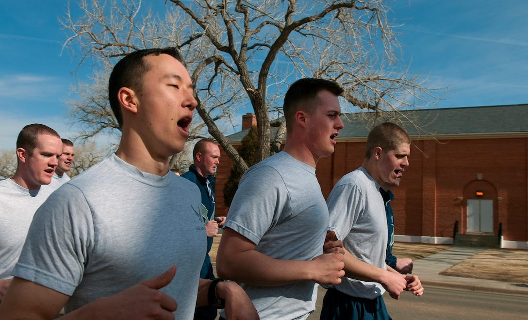 """Airmen of the 90th Security Forces Group of F. E. Warren Air Force Base sing cadence as the take part in their group's two-mile """"pride run"""" March 29. (U.S. Air Force photo by R.J. Oriez)"""