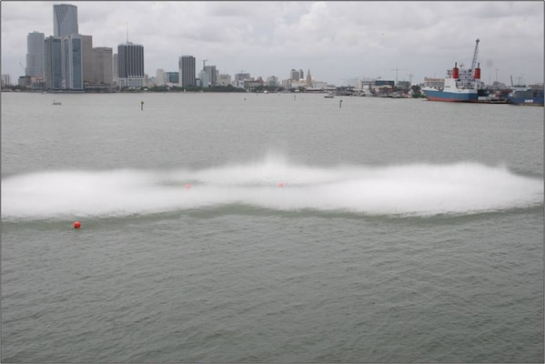 Confined blasting method, using 3,000 pounds of explosives to crack rock beneath the water's surface in Miami Harbor.