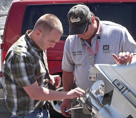 Walla Walla District motorboat instructor, Paul Pence, showing District Office civil engineer, Arron Schuff, how to properly change a boat propeller at the District Motorboat Licensing course.  All Corps of Engineers employees who operate USACE boats/vessels less than 26 feet in length are required to be trained, tested and licensed in accordance with recognized Federal, state and local laws and standards.