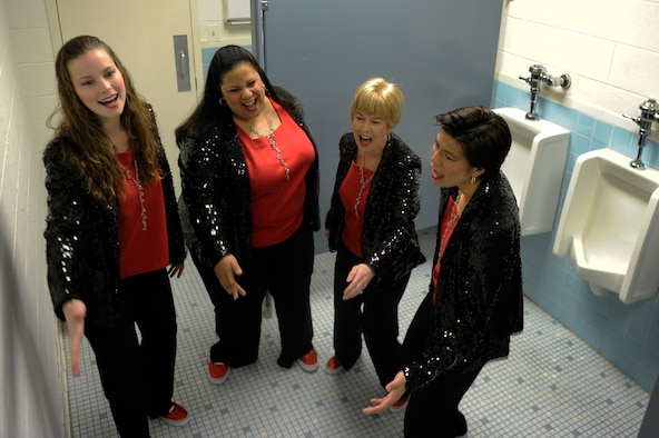 Col. Michelle Barrett (right) sings vocal warm-ups with The Excel Quartet of the Vienna-Falls Chorus of Fairfax, Va April 2, 2013. The quartet sings in the bathroom to take advantage of the great acoustics. The Excel quartet is the rookie quartet of the VF Chorus. (U.S. Air Force photo/Senior Airman Carlin Leslie)