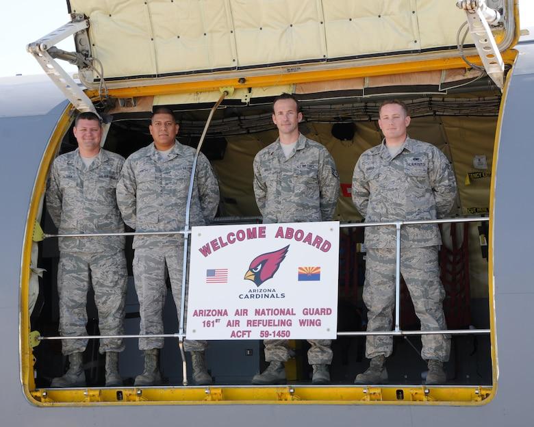 """Tech. Sgt. Erik Calderon, Staff Sgt. Patrick Sanchez, Senior Airman Josh Briles and Senior Airman Nick Savasta, 161st Maintenance Group crew chiefs, win the unit's award for Outstanding Aircraft of the Second Quarter with a Mission Capability Rating of 94.09 percent at the 161st Air Refueling Wing, Phoenix, April 7, 2013. Assigned to aircraft #59-1450 """"Red Bird"""", these Airmen maintained their jet throughout 28 sorties and 100.6 flying hours over the past three months and beat out eight other crews in competition for this award being judged on a combination of expertise and flawless inspections. (Air National Guard Photo by Staff Sgt. Courtney Enos/Released)"""