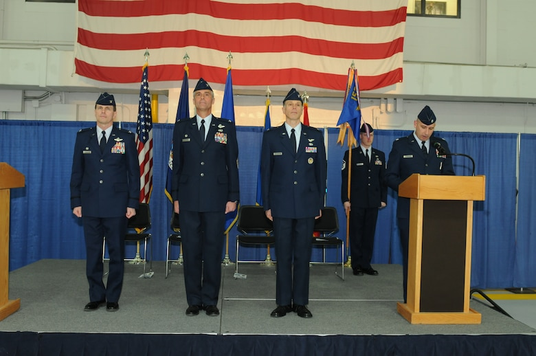 New York Air National Guard Col. Greg Semmel (left), Commander of the 174th Attack Wing, officiates the 152nd Air Operations Group's Change of Command ceremony held at Hancock Field Air National Guard Base, Syracuse, New York on 6 April, 2013.  During the ceremony, Col. Mark Murphy (second from left) turned over command to Col. Michael Comella. (New York Air National Guard photo by Tech. Sgt. Justin A., Huett/Released)