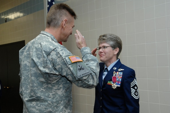 The Adjutant General of the Utah National Guard, Maj. Gen. Jefferson S. Burton, and State Command Chief Master Sergeant Denise Rager exchanged salutes during Rager's retirement ceremony at the Utah Air National Guard base, April 6, 2013. After 27 years of dedicated military service, Rager formally retired as the top enlisted service member in the Utah Air Guard. (U.S. Air Force photo by Senior Master Sgt. Gary Rihn)(RELEASED)