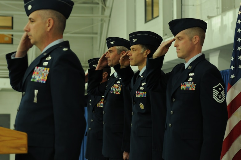 New York Air National Guard Col. Michael Comella (second from right), incoming Commander of the 152nd Air Operations Group, stands next to Col. Mark Murphy (third from right), outgoing 152nd Commander, during the playing of the National Anthem at a Change of Command ceremony held on April 6, 2013 at Hancock Field Air National Guard Base, Syracuse, NY. (New York Air National Guard photo by Tech. Sgt. Justin A. Huett/Released)
