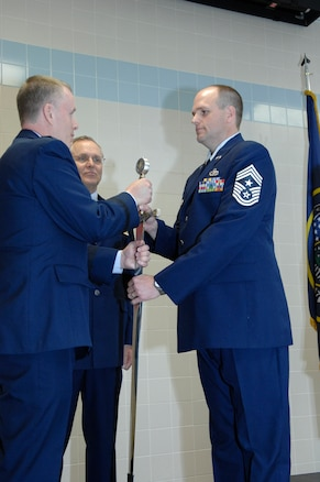 Chief Master Sgt. Michael Edwards accepted the sword from the Director of the Utah National Guard's Joint Staff, Brig. Gen. Kenneth L. Gammon, and assumed position as the new State Command Chief of the Utah Air National Guard during a ceremony at the Utah ANG base, April 6. In the passing-of-the-sword ceremony, the sword represents the duties and responsibilities of the State Command Chief Position. Edwards was formerly the State Human Resources Advisor and assumed position from State Command Chief Master Sergeant Denise Rager, who formally retired immediately after the passing-of-the-sword ceremony. Edwards is now the top enlisted service member in the Utah Air National Guard. (U.S. Air Force photo by Senior Master Sgt. Gary Rihn)(RELEASED)