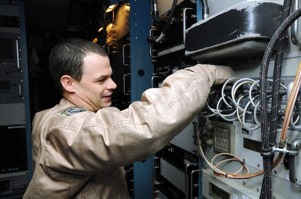 Tech. Sgt. Justin Longway, 41st Expeditionary Electronic Combat Squadron airborne maintenance technician, checks a patch panel aboard an EC-130 Compass Call aircraft on Bagram Airfield, Afghanistan, March 23, 2013. The 41st EECS flies nightly missions in support of troops on the ground. (U.S. Air Force photo/Staff Sgt. David Dobrydney)