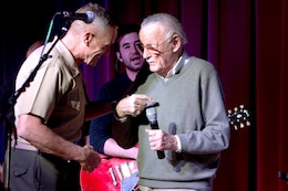 Brig. Gen. Vincent A. Coglianese, left, welcomes Stan Lee, right, to Pendleton during while giving opening remarks during Stan Lee's POW!er Concert at the Pacific Views Event Center here April 5. Coglianese is the base commanding general and regional authority for five military installations in the southwestern United States. Lee is the chairman and chief creative officer of POW! Entertainment.