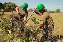 Philippine Army Private First Class Numancia Belerieno and Marine Corps Corporal Michael Hensell fix a fence at Lawin elementary school. The project is one of eight engineering civic action programs (ENCAP) missions being performed by Joint Civil Military Operations Task Force (JCMOTF) units in support of exercise Balikatan 2013. Balikatan is an annual Republic of the Philippines-U.S. military bilateral training exercise and humanitarian assistance engagement.