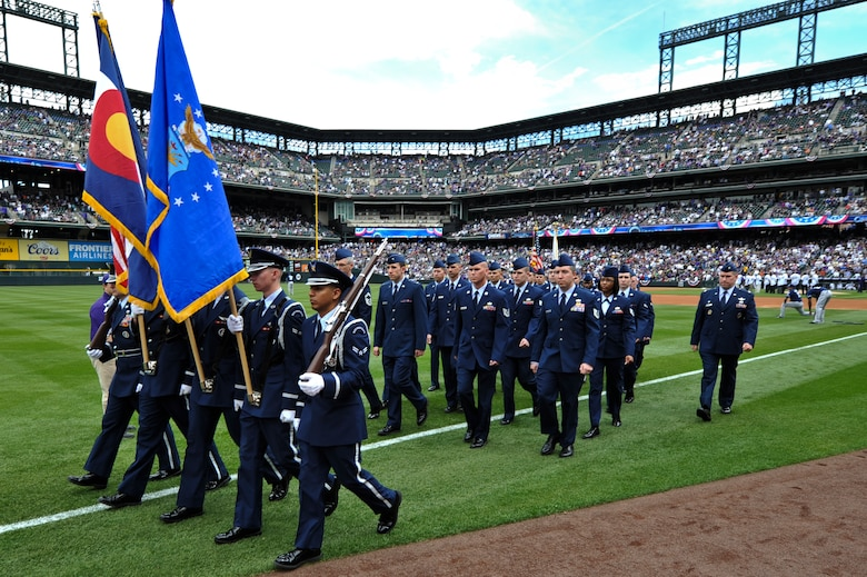 Team Buckley members march during the Colorado Rockies Opening Day ceremony April 5, 2013, at Coors Field, Denver. Service members from all U.S. military branches stood in formations as local law enforcement and fire department members unfurled the flag during the opening day ceremonies. (U.S. Air Force photo by Airman 1st Class Riley Johnson/Released)