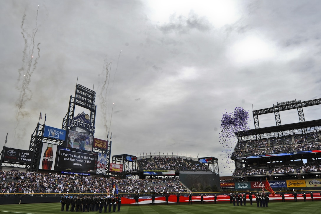 The crowd cheers as fireworks explode and balloons are released at the Colorado Rockies Opening Day April 5, 2013, at Coors Field, Denver.  Service members from all U.S. military branches stood in formations as local law enforcement and fire department members unfurled the flag during the opening day ceremonies. (U.S. Air Force photo by Airman 1st Class Riley Johnson/Released)