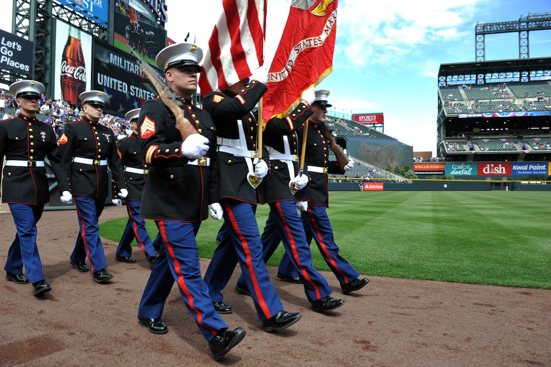 Marine Corps members present the colors at the Colorado Rockies Opening Day April 5, 2013, at Coors Field, Denver. Service members from all military branches participated in the opening day ceremonies. (U.S. Air Force photo by Airman 1st Class Riley Johnson/Released)