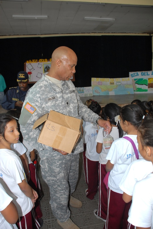 Army Lt. Col. Michael Frazier, Director of Civil Affairs, hands out soaps to the students of Rosa de Valenzuela.Joint Task force-Bravo in cooperation with the Comayagua Police provided 750 bars of soap to the local school, Rosa de Valenzuela, as part of JTF-B continuous engagement and commitment to Honduras, April 5.