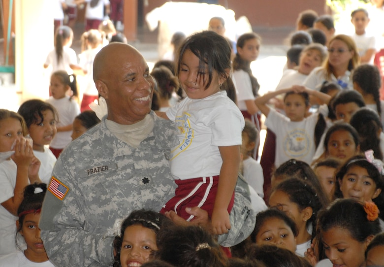 Army Lt. Col. Michael Frazier, Director of Civil Affairs, talks with one of the students at Rosa de Valenzeula. Joint Task force-Bravo in cooperation with the Comayagua Police provided 750 bars of soap to the local school, Rosa de Valenzuela, as part of JTF-B continuous engagement and commitment to Honduras, April 5.
