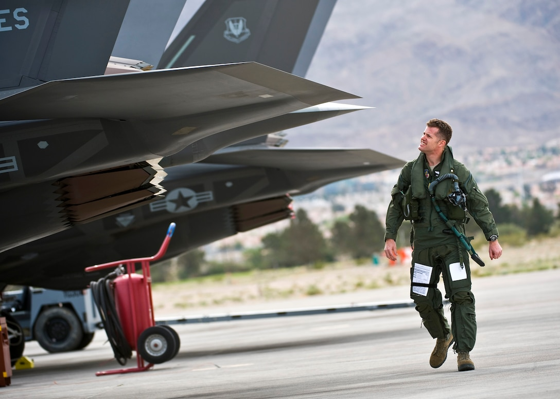 U.S. Air Force Lt. Col. Benjamin Bishop, 422nd Test and Evaluation Squadron director of operations, inspects the exhaust of an F-35A Lightning II before a training mission April 4, 2013, at Nellis Air Force Base, Nev. The F-35A is assigned to the 422nd TES and its modern engine delivers more than 60 percent more thrust than other aircraft of the same weight. (U.S. Air Force photo/Senior Airman Brett Clashman)