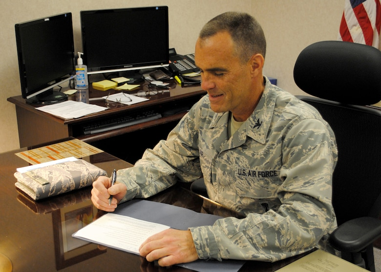 Col. David Lair, 341st Maintenance Group commander, finishes up some paperwork at his desk April 2.  Lair took over as commander of the 341st MXG on March 15.  (U.S. Air Force photo/Senior Airman Cortney Paxton)