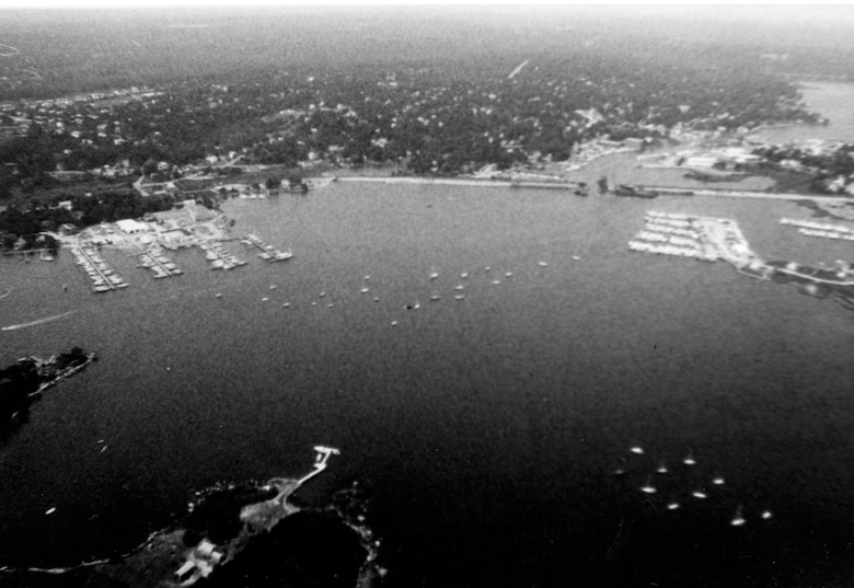 Aerial view of Mystic Harbor. The Mystic River extends from Mystic Harbor in Mystic six miles upstream to Old Mystic. Both Mystic and Old Mystic are sections of Stonington, CT.  Photo was taken in July 1983.
