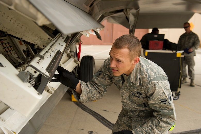 Senior Airman Andrew Guise, 49th Aircraft Maintenance Squadron load team member, checks the connection points on the F-22 Raptor aircraft during the quarterly load-crew competition at Holloman Air Force Base, N.M., April 5. The F-22 load-crew competed in the load-crew competition to have their skills evaluated alongside the MQ-9 Reaper and German Air Force load-crews. For the competition, points are awarded during the weapons loading, tool kit inspection, and uniform inspection. (U.S. Air Force photo by Airman 1st Class Michael Shoemaker/Released)