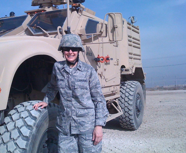 U.S. Air Force Capt. Jennifer Millington, 366th Medical Operations Squadron physical therapist, stands in front of her Mine Resistant Ambush Protected All Terrain Vehicle, Oct. 20, 2011, at Bagram Airfield, Afghanistan. Millington used this vehicle to travel across base carrying her treatment table with her to treat patients at compounds outside of the hospital. (Courtesy photo)