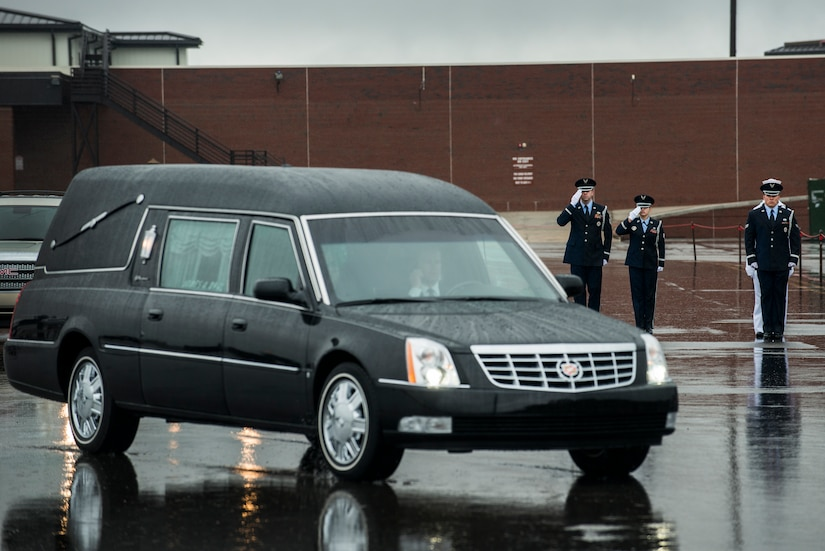 Members of the Joint Base Charleston Honor Guard salute as the funeral procession for U.S. Army Chief Warrant Officer 5th Class Curtis Reagan, 43, of Summerville, S.C departs April 4, 2013, at Joint Base Charleston – Air Base, S.C. Reagan died March 29, 2013, in Kandahar, Afghanistan, from a non-combat related illness. Reagan's remains were flown from Dover, Del., to Charleston. (U.S. Air Force photo/ Senior Airman George Goslin)(RELEASED)