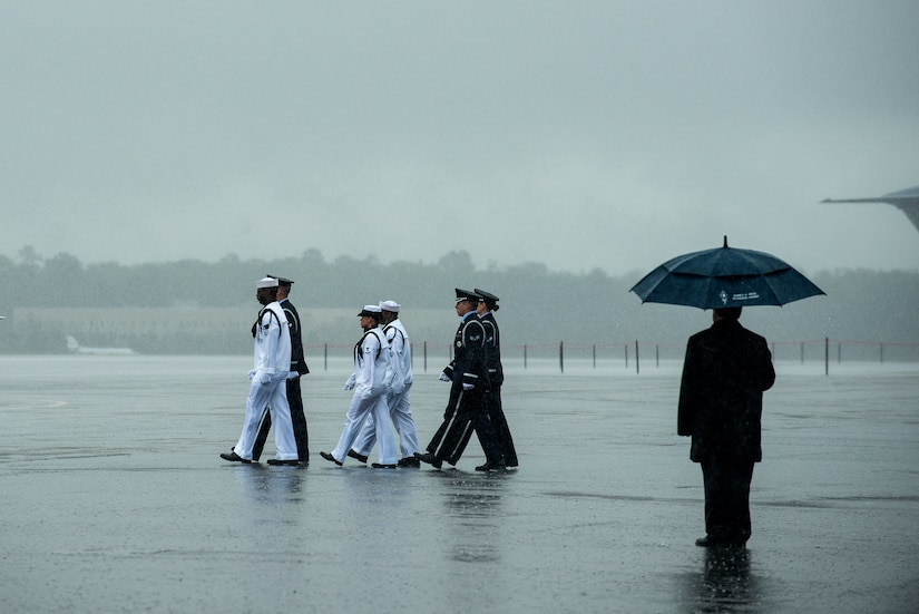 Members of the Joint Base Charleston Honor Guard march toward the casket containing the body of U.S. Army Chief Warrant Officer 5th Class Curtis Reagan, 43, of Summerville, S.C., April 4, 2013, at Joint Base Charleston – Air Base, S.C. Reagan died March 29, 2013, in Kandahar, Afghanistan, from a non-combat related illness. Reagan's remains were flown from Dover, Del., to Charleston. (U.S. Air Force photo/ Senior Airman George Goslin)(RELEASED)