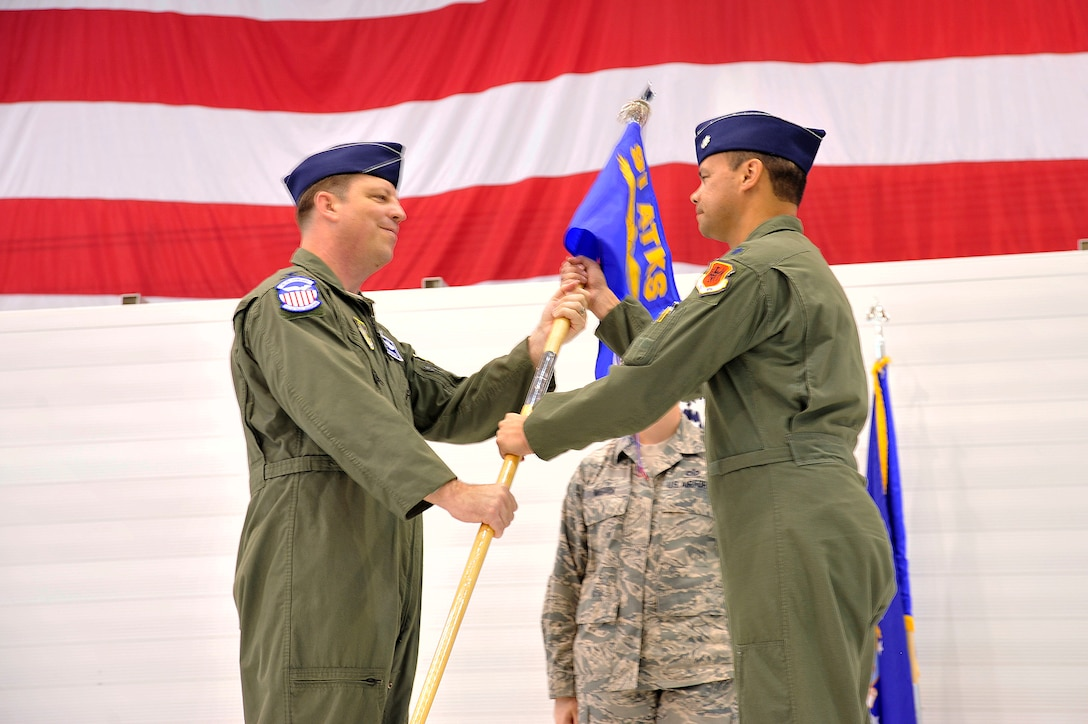 LAS VEGAS, Nev. – Col. John Breeden, 926th Group Commander, left, passes the guidon to Lt. Col. Joseph during the 91st Attack Squadron activation ceremony April 5, 2013. Flying MQ-1B Predator and MQ-9 Reaper remotely piloted aircraft, the 91st ATKS conducts worldwide operations enabling persistent, real-time intelligence, surveillance and reconnaissance. (U.S. Air Force photo by Senior Master Sgt. P.H.)