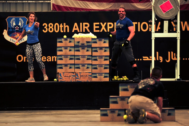 """U.S. Air Force Master Sgt. Michael Garcia, 380th Expeditionary Communications Squadron first sergeant, competes against American Gladiators, Jennifer """"Phoenix"""" Widerstrom and Hollywood """"Wolf"""" Yates, during the Assault competition at an undisclosed location in Southwest Asia April 6, 2013. The Gladiators and Billy Blanks visited several bases in Southwest Asia during an Armed Forces Entertainment Fitness Tour. (U.S. Air Force photo by Tech. Sgt. Christina M. Styer/Released)"""