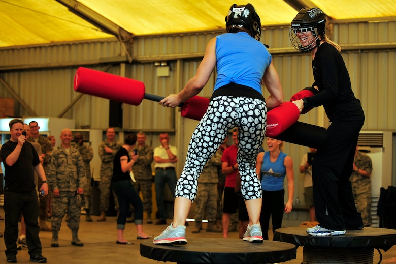 """U.S. Air Force Col. Laura Lenderman, 380th Air Expeditionary Wing vice commander, competes against American Gladiator, Jennifer """"Phoenix"""" Widerstrom, during the Joust competition at an undisclosed location in Southwest Asia April 6, 2013. The Gladiators and Billy Blanks visited several bases in Southwest Asia during an Armed Forces Entertainment Fitness Tour. (U.S. Air Force photo by Tech. Sgt. Christina M. Styer/Released)"""