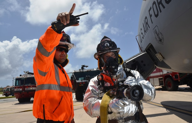 Master Sgt. Essam Cordova, 36th Civil Engineer Squadron Fire and Emergency Services assistant chief of operations during 2012, stands with Tech. Sgt. Arnold Castro, 36th CES Fire and Emergency Services station captain, during an aircraft fire training exercise on Andersen Air Force Base, Guam, April, 4, 2013. Castro was awarded the Navy Fire and Emergency Services Military Firefighter of the Year and Cordova was awarded Navy Fire and Emergency Services Military Fire Officer of the Year.  (U.S. Air Force photo by Staff Sgt. Veronica McMahon/Released)