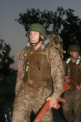 "Sgt. Adam K. Smith completes a night hike during the culminating event of his Marine Corps Martial Arts Instructor course at Naval Air Station/Joint Reserve Base New Orleans, Sept. 14, 2011. Smith, the repairable issue point chief for Marine Forces Reserve G4 (logistics and services), was awarded the Navy and Marine Corps Commendation Medal after he was selected as the MARFORRES 2012 Marine of the Year (active component). Smith uses the training he received to train other Marines to ""belt-up"" in MCMAP."