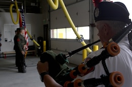 "Dennis Rogers plays the bagpipe as Security and Emergency Battalion Color Guard ""post the colors"" during the dedication ceremony of Pendleton's Fire Station 10 in honor of Sgt. Brian E. Dunlap here April 6. Rogers is a pipe major with the San Diego County Firefighters Pipes and Drums band. Dunlap was an advisor for the Iraqi Army and firefighter with the Camp Pendleton Fire Department and in 2005 and was killed by an improvised explosive device while conducting combat operations against enemy forces in Abu Fleiss, Iraq."
