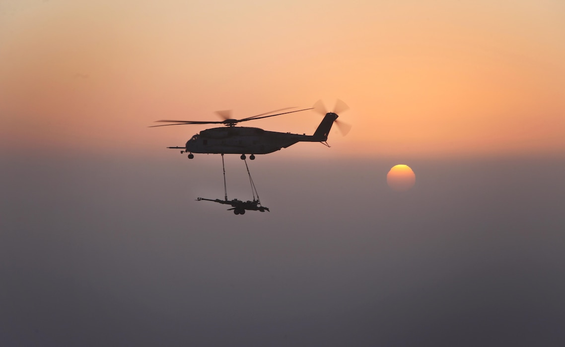 A U.S. Marine Corps CH-53E Super Stallions with Marine Heavy Helicopter Squadron (HMH) 361, Marine Aircraft Group 16, 3rd Marine Aircraft Wing (Forward), externally lifts M777 howitzers over Helmand province, Afghanistan, Dec. 29, 2012. HMH-361 provided aerial support by repositioning the howitzers to Camp Dwyer.  (U.S. Marine Corps photo by Sgt. Keonaona C. Paulo)