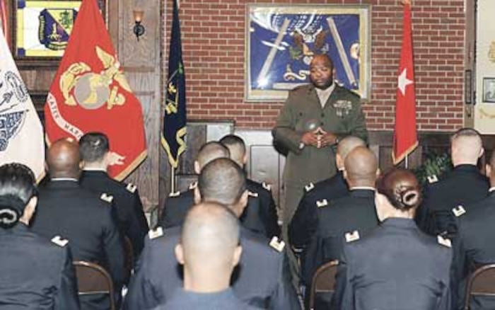 Marine Chief Warrant Officer 5 Domah Diggs, CBRN Warrant Officer Basic Course director, addresses recent graduates of the Interservice Training Review Organization-Chemical, Biological, Radiological, Nuclear Warrant Officer Basic Course.