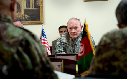 Gen. Martin E. Dempsey, chairman of the Joint Chiefs of Staff at a meeting with Gen. Sher Mohammad Karimi, Chief of the General Staff of the Afghan Army, in Kabul, Afghanistan, Apr. 6, 2013.