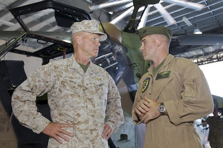U.S. Marine Corps Gen. James F. Amos, left, the commandant of the Marine Corps, views an Australian Army Tiger armed reconnaissance helicopter with Marine Corps Capt. J.R. Neagle during a tour of the Australian Army's Robertson Barracks in Darwin, Australia, Aug. 9, 2012. Amos toured the facility as part of a visit with U.S. Marines who were among the first stationed in Australia.