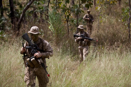 Marines patrol through thick grass at Kangaroo Flats Training Area April 18. During a weeklong field exercise, the Marines trained at several different ranges where they executed combat marksmanship, foot patrols, and ambushes to accustom themselves to operating in the Australian outback. The Marines with Company F, 2nd Battalion, 3rd Marine Regiment, 3rd Marine Division, III Marine Expeditionary Force are the first to deploy to Australia under a bilateral agreement to establish a rotational Marine presence in Darwin.