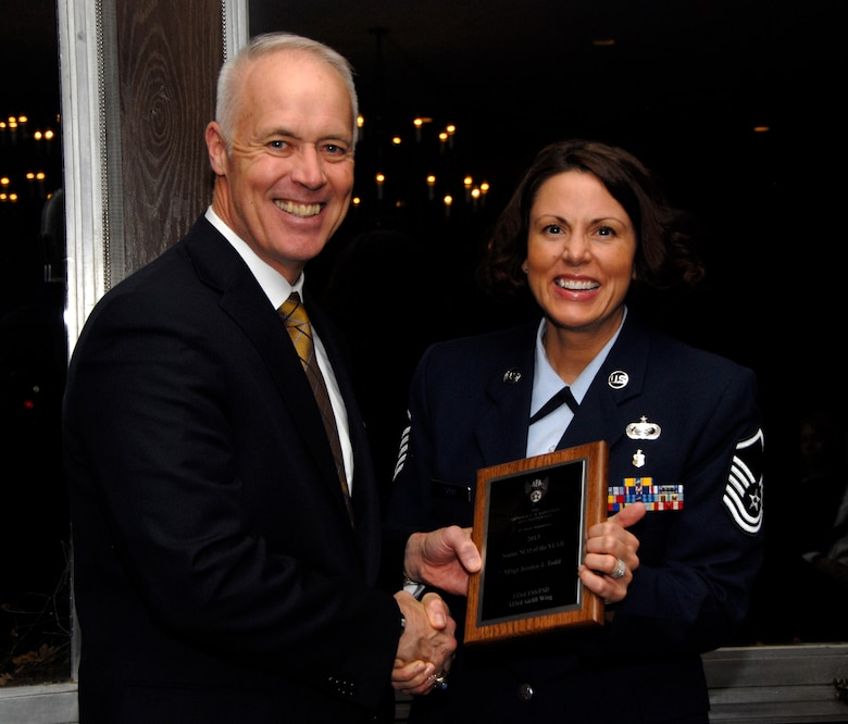 Master Sgt. Jessica Todd, 133rd Force Support Squadron, receives an award from Retired U.S. Air Force Lt. Gen. Richard Newton, Executive Vice President of the Air Force Association in St. Paul, Minn., Apr. 5, 2013. Todd is being honored for being the 133rd Airlift Wing Senior NCO of the Year during the Air Force Association's Annual Awards Dinner. (U.S. Air Force photo by Airman 1st Class Kari Giles /Released)