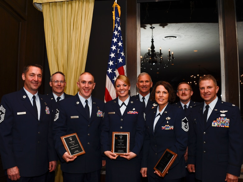 Members of the Minnesota Air National Guard pose for a photograph after the Air Force Association's (AFA) Annual Awards Dinner in St. Paul, Minn., Apr. 5, 2013. The AFA honored the 133rd Airlift Wing 2013 Outstanding Airmen of the Year for their achievements. (U.S. Air Force photo by Staff Sgt. Amy M. Lovgren/Released)