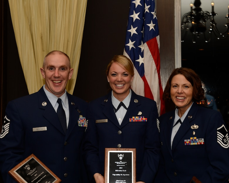 Master Sgt. Ryan Fenton, left, Tech. Sgt. Ashley Ingvalson, middle, and Master Sgt. Jessica Todd pose for a group photograph in St. Paul, Minn., Apr. 5, 2013. Fenton, Ingvalson, and Todd are the 133rd Airlift Wing 2013 Outstanding Airmen of the Year and the Air Force Association honored them for their achievements. (U.S. Air Force photo by Staff Sgt. Amy M. Lovgren/Released)